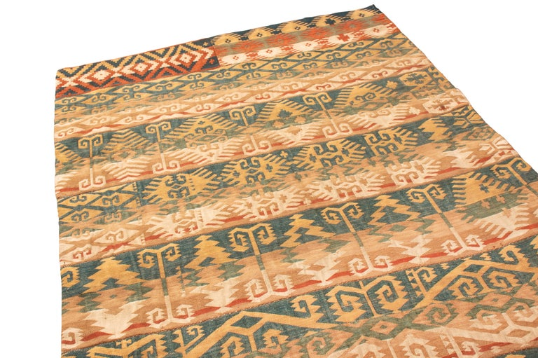 Originating from Persia in 1920, this antique Persian wool Kilim rug from Rug & Kilim is from the declining Jajim family of rugs. Hand knotted in high-quality wool in pristine condition, Jajim rugs are increasingly harder to find intact from this