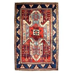 Antique Persian Kazak Carpet in Red, Blue, and Cream Wool