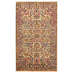 Antique Persian Kerman Oriental Rug, in Small Size, with Ivory Field and Flowers
