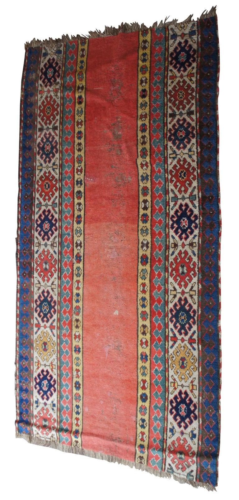 Antique Persian rug runner featuring long floral and geometric designs. Reds, greens, blues, brown, yellow, tan, pink. Measure: 73