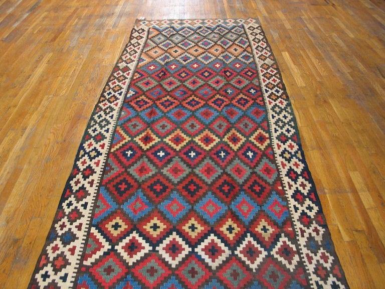 Antique Persian Kilim rug. Size: 4'6