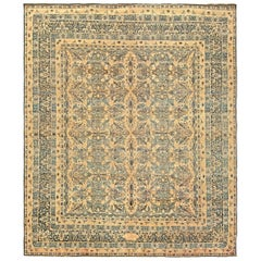 Antique Persian Kirman Beige, Inky Blue, Green and Brown Wool Rug