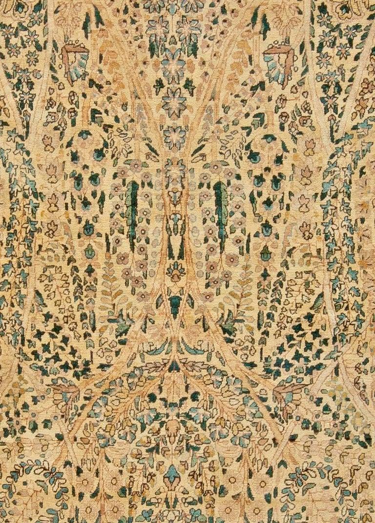 Antique Persian Kirman handwoven wool carpet Size: 10'2
