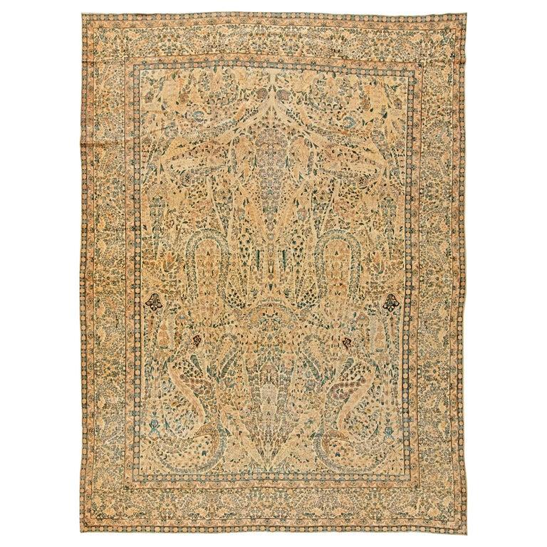Antique Persian Kirman Handwoven Wool Carpet For Sale