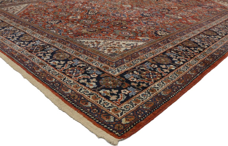 73333 Antique Persian Mahal rug. Regal hues, intricate details, and all-over symmetry create a neoclassical style in this hand knotted wool distressed antique Persian Mahal rug. The all-over Herati pattern is composed of lotus, palmettes and floral