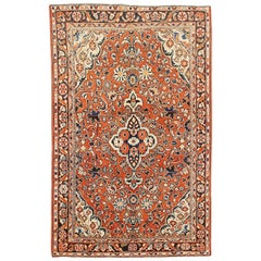 Antique Persian Mahal Rug with Blue and White Floral Details on Rust Field