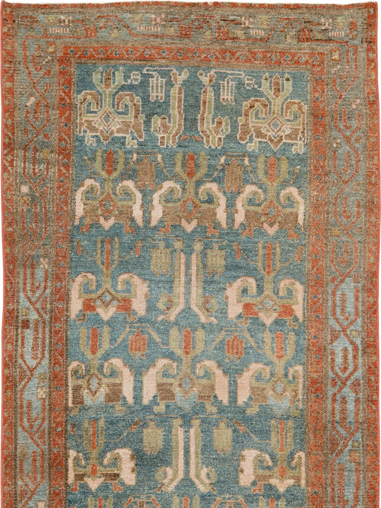 An antique Persian Malayer rug from the early 20th century.