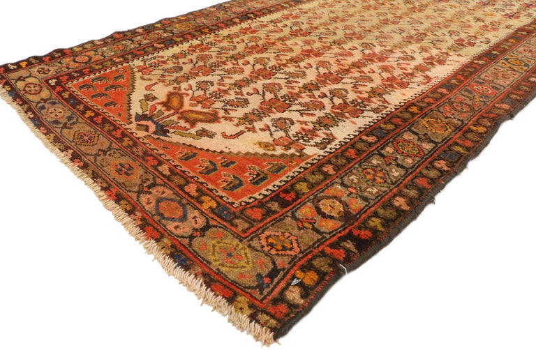 70740, Antique Persian Malayer Runner, Hallway Runner. This hand knotted wool antique Malayer runner features an all-over blooming Qashqai style boteh pattern like butterflies atop plant stems. This sumptuous example of Malayer weaving features all