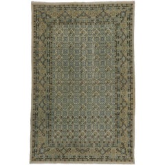 Antique Persian Mashhad Rug with Soft, Light Colors