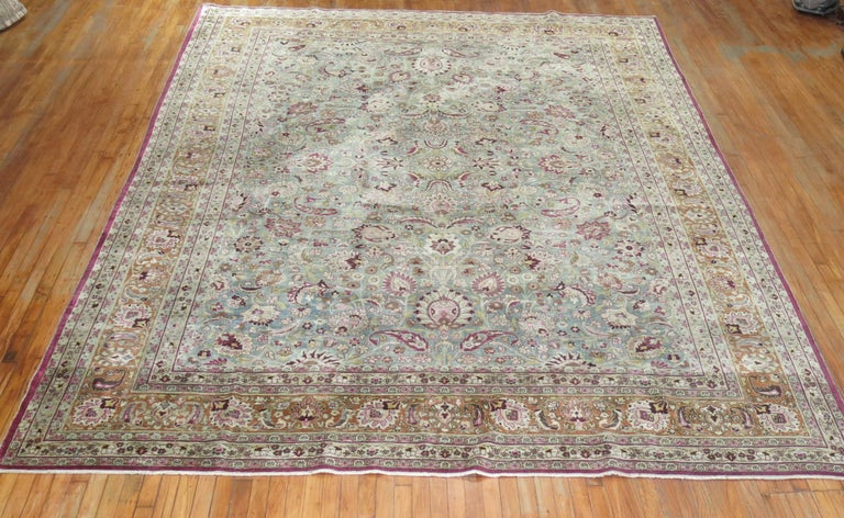 An early 20th century room size antique Persian Meshed rug.