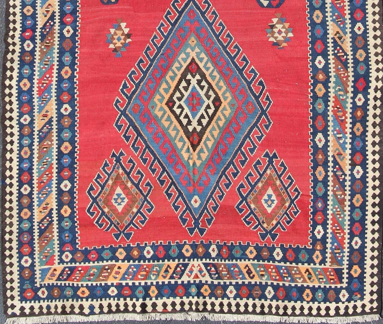 Vibrant color-toned Geometric Design Kilim Runner antique Qashqai Kilim Gallery from Persia, rug 19-0402, country of origin / type: Iran / Kilim, circa 1920  Featuring a geometric diamond medallion design, with complementary geometric motifs