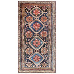Antique Persian Qashqai Rug with Four-Medallion Design in Blue, Red, Brown Tones