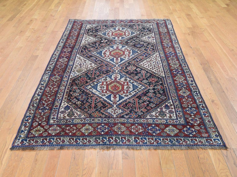 This is a truly genuine one of a kind antique Persian Qasqui tribal geometric even wear hand knotted rug. It has been knotted for months and months in the centuries-old Persian weaving craftsmanship techniques by expert artisans.  Origin of weaving