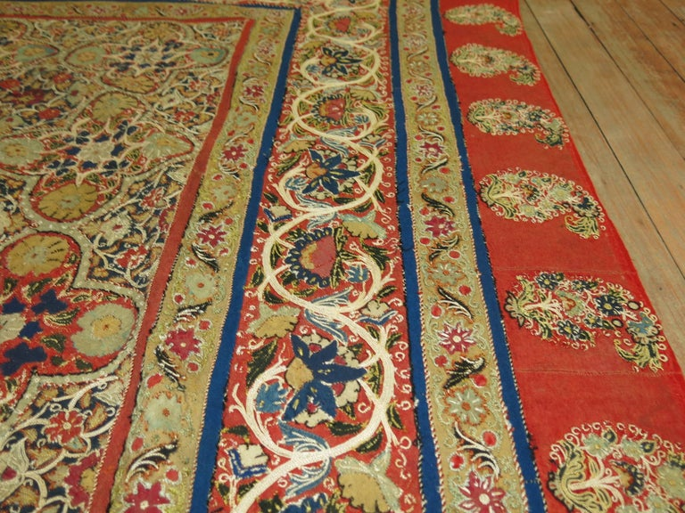 Hand-embroidered Chain stitched Suzani textile made in the middle of the 20th century. Silk elements found in the design with glowing vibrant colors executed by the weaver. Measures: 4'7