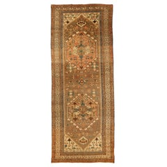 Antique Persian Rug Serapi Design in Green and Brown Tribal Details, circa 1920s