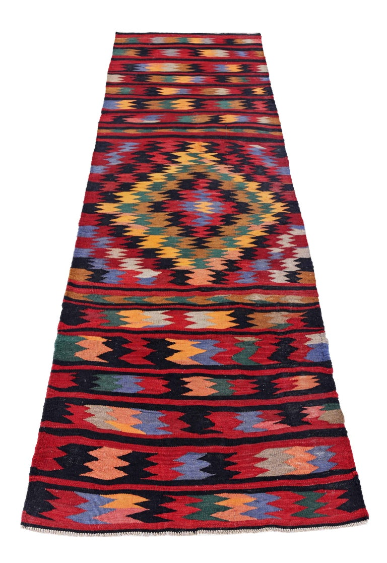 Antique Persian runner rug handwoven from the finest sheep's wool. It's colored with all-natural vegetable dyes that are safe for humans and pets. It's a traditional Kilim design handwoven by expert artisans. It's a lovely runner rug that can be