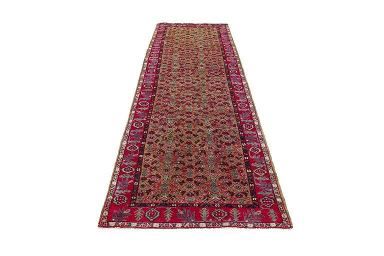 Antique Persian runner rug handwoven from the finest sheep's wool. It's colored with all-natural vegetable dyes that are safe for humans and pets. It's a traditional Sultanabad design handwoven by expert artisans. It's a lovely runner rug that can