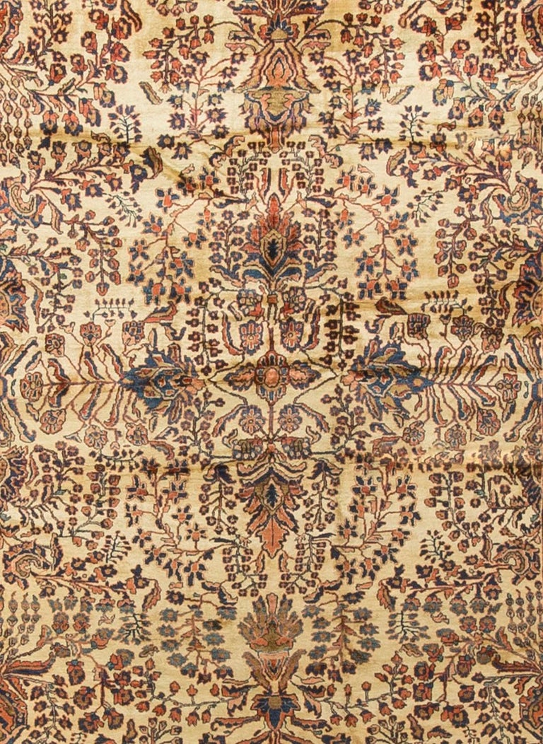 Antique Persian Sarouk Rug Circa 1900. The distinctive colors of this Sarouk rug reflects the style that became so popular in the USA at the beginning of the 20th century. The soft rust-red ground so well complimented by the floral patterns in blues