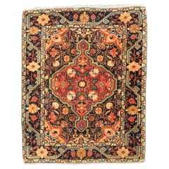 Antique Persian Sarouk Faraghan Small Rug with Medallion Design