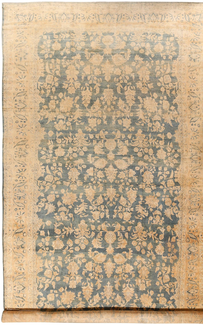 Antique Persian Sarouk rug, circa 1900. A wonderful antique Persian Sarouk oversize rug with pale soft colors. The vintage rugs of Sarouk are from the Arak province town of that name and surrounding village, the wool is amazingly good and the dyes,
