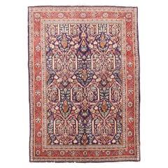 Antique Persian Sarouk Rug with Blue and Orange Botanical Details