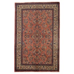 Antique Persian Sarouk Rug with Blue and Ivory Flower Heads on Red Center Field