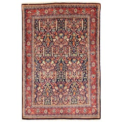 Antique Persian Sarouk Rug with Colored Botanical Details on Navy Blue Field