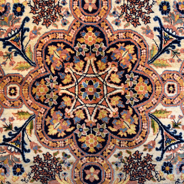 """Measuring 4'7"""" x 6'6"""", this antique Persian Semnan carpet is hand-knotted and utilizes beautiful and subtle shades of cream, black, and pink. This piece was hand-knotted using a traditional Persian weave, which provides a plush pile and a durable"""