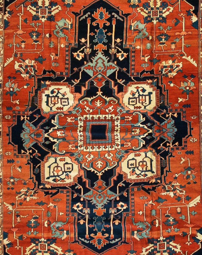 This is an exquisite hand knotted antique Persian Serapi carpet with a medallion geometric design from circa 1880-1900. This rug measures 12 x 19.6 ft. and is in pristine condition.