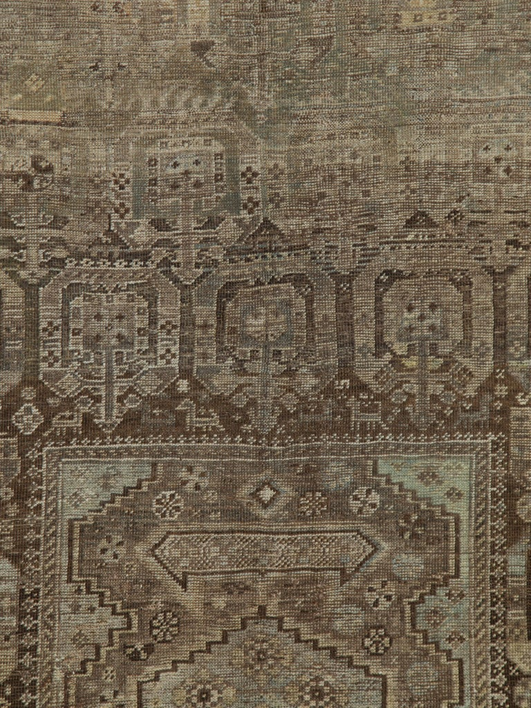 An antique Persian Shiraz rug from the early 20th century.  Measures: 5' 10