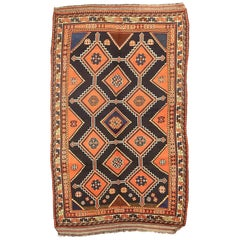 Antique Persian Shiraz Rug with Floral and Geometric Medallions on Black Field