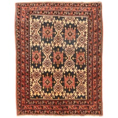 Antique Persian Sirjan Rug with Black and Red Geometric Medallions