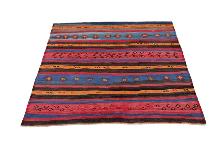 Antique Persian square rug handwoven from the finest sheep's wool. It's colored with all-natural vegetable dyes that are safe for humans and pets. It's a traditional Kilim design handwoven by expert artisans. It's a lovely square rug that can be