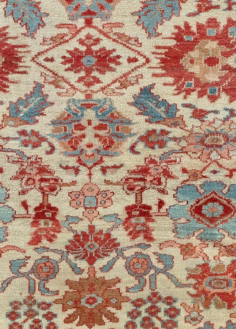 Antique Persian Sultanabad beige, blue, brown, pink and red (size adjusted) handwoven wool antique rug.