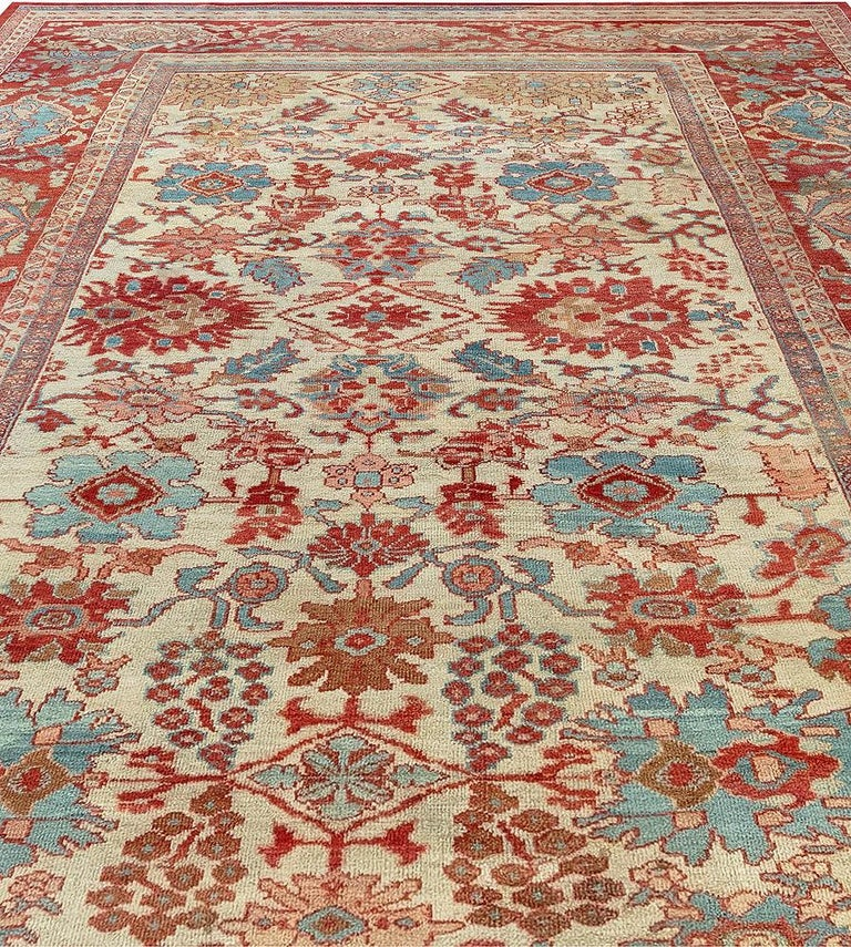 Hand-Knotted Antique Persian Sultanabad Beige, Blue, Brown, Pink and Red Wool For Sale