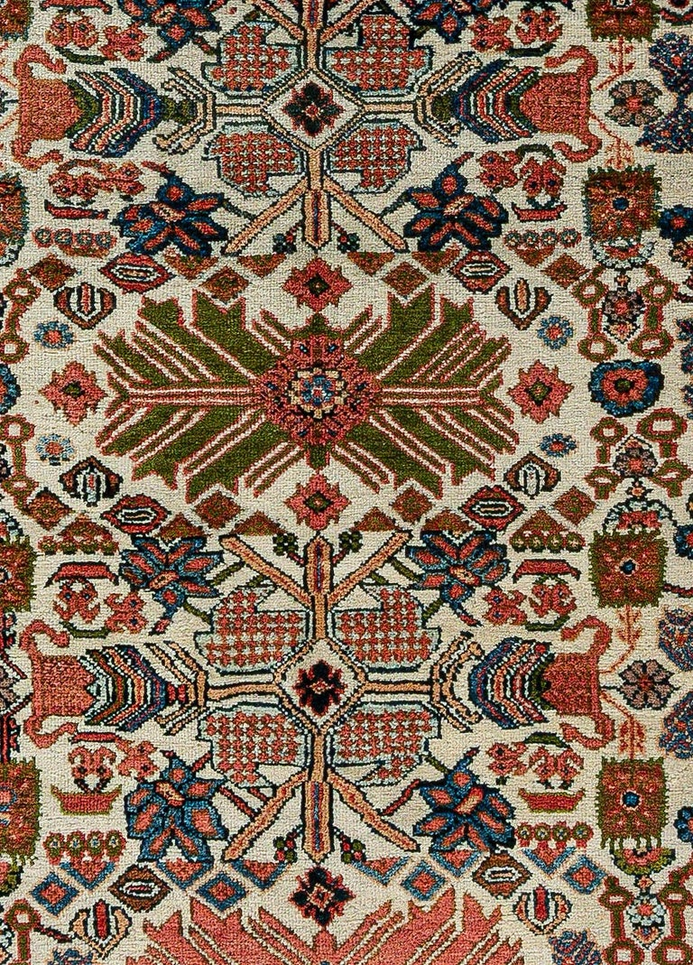 Antique Persian Sultanabad rug (Size Adjusted) in beige, blue, green, orange and red.