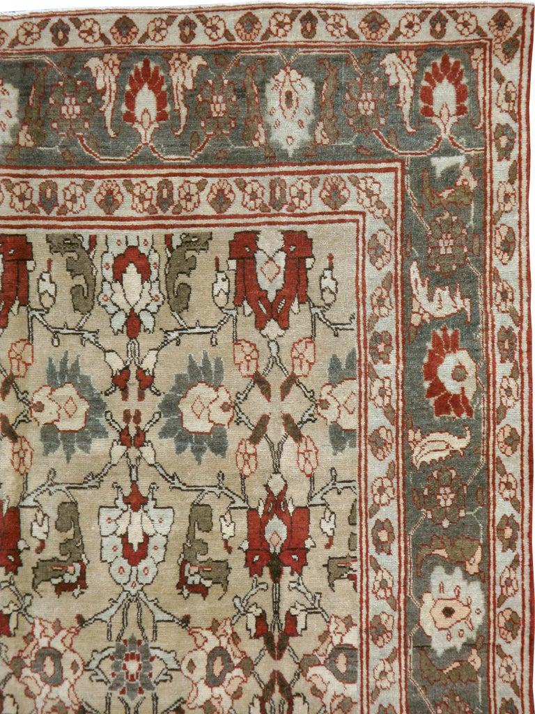 Rustic Antique Persian Tabriz Carpet For Sale