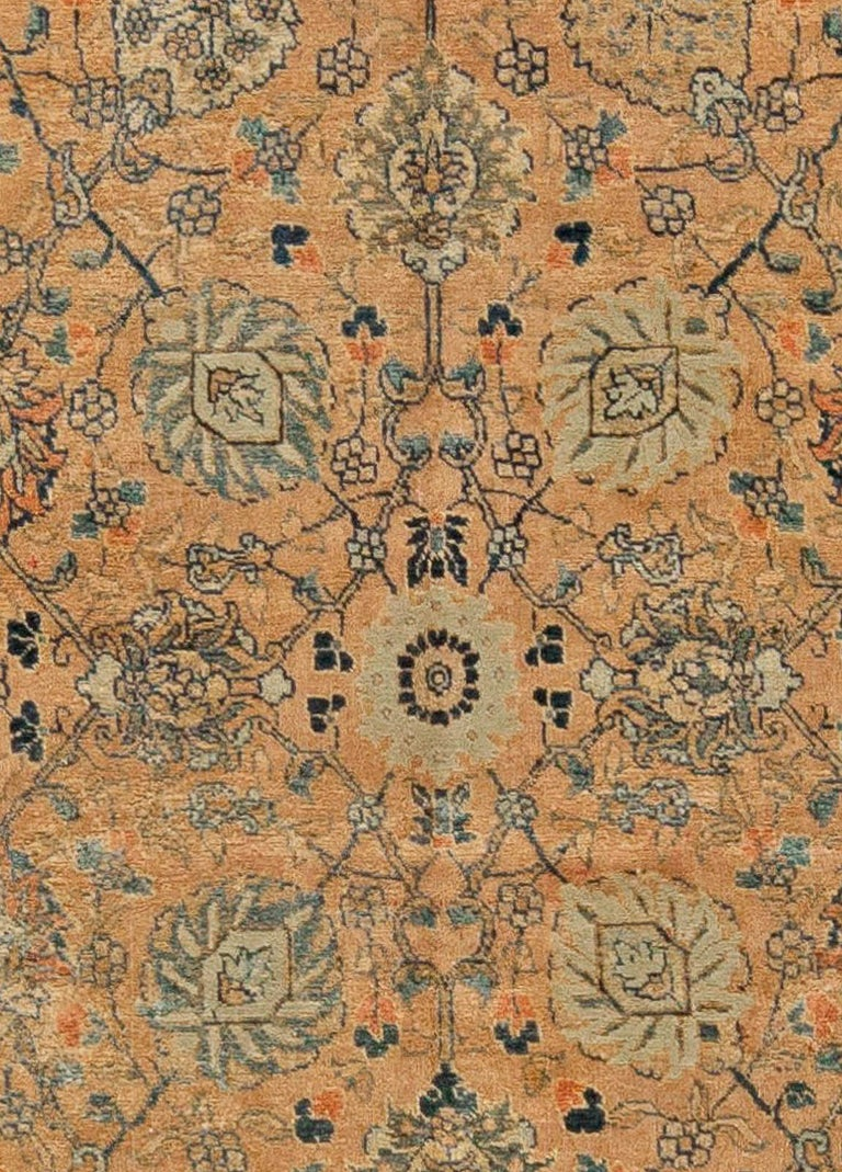 Antique Persian Tabriz rug Size: 7'0