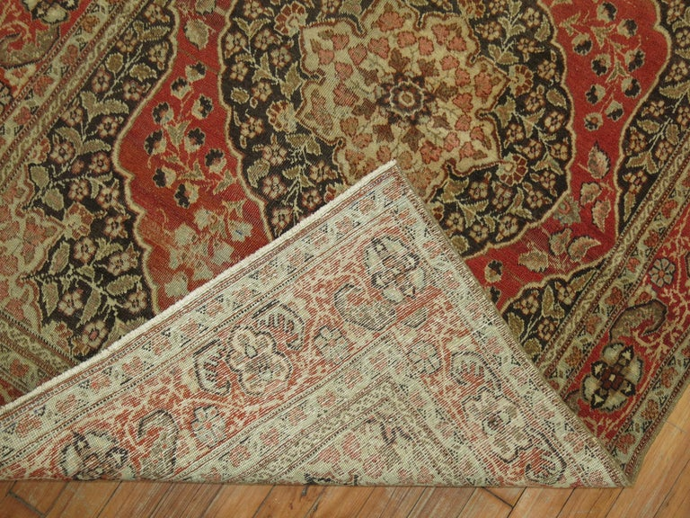 An early 20th century authentic antique Persian Tabriz rug.