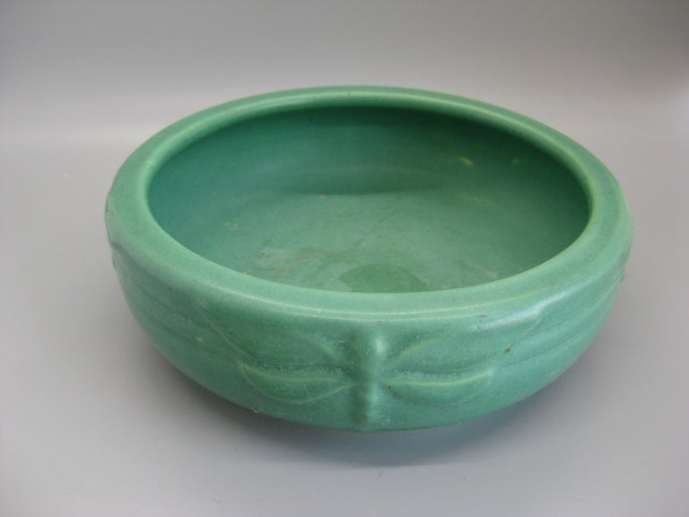Wonderful Arts & Crafts green matte art pottery bowl made by Peters & Reed in Zanesville, Ohio. Dates from the early 1900s. Wonderful color and shape. Has dragonflies around the sides as decorations. Would look great in any Arts & Crafts decor. In