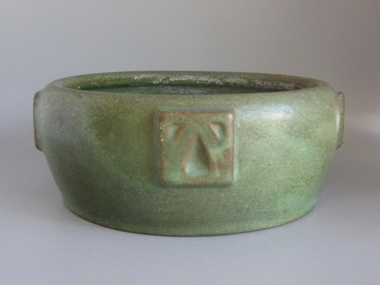 Wonderful Arts & Crafts green matte art pottery bowl made by Peters & Reed in Zanesville, Ohio. Dates from the early 1900s. Wonderful color and shape. Has decorations on the sides. Would look great in any Arts & Crafts decor. In very nice original