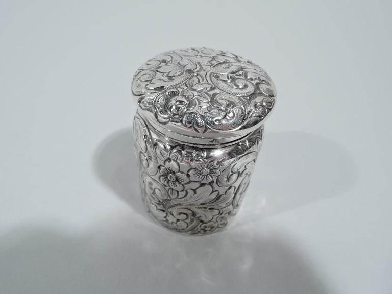 Turn-of-the-century sterling silver portable inkwell. Drum-form with hinged and cork-lined cover. Repousse scrolls, leaves, and flowers on sides and cover top. A nice piece with strong regional associations. Fully marked with maker's stamp for