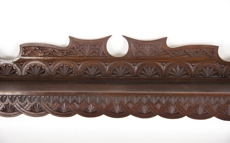 Antique plate rack, solid walnut, Victorian, chip carved, hanging shelf, Scotland, 1880  Scotland, 1889 Solid walnut construction Original finish Smothered in crisp chip carving Full shelf above Three shelves below are grooved for the plats to sit