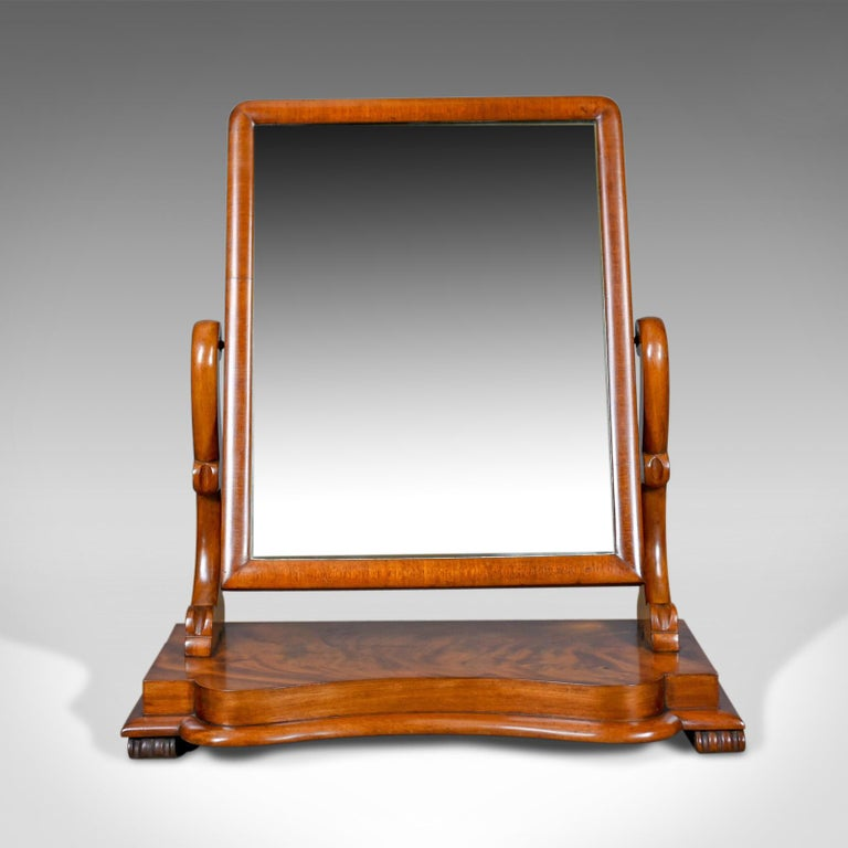 This is an antique platform mirror in flame mahogany. English Victorian vanity, dating to the 19th century, circa 1870.  A large adjustable platform, vanity mirror Flame mahogany displaying grain interest and a desirable aged patina Good