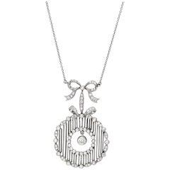 Antique Platinum and Diamond Bow Pendant circa 1910 1.50 Carat of Total Diamonds
