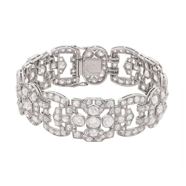 A luxurious ensemble of old cut diamonds glitters from every angle in this stunning platinum and diamond bracelet, which came on the cusp of the late Victorian and early Edwardian eras.  Handmade at the turn of the twentieth century, this antique