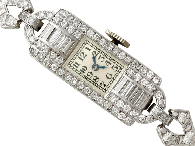 A stunning, fine and impressive antique 2.24 carat diamond and platinum Art Deco cocktail watch; part of our antique watch and diamond jewelry collections  This stunning antique diamond cocktail watch has been crafted in platinum.  This ladies