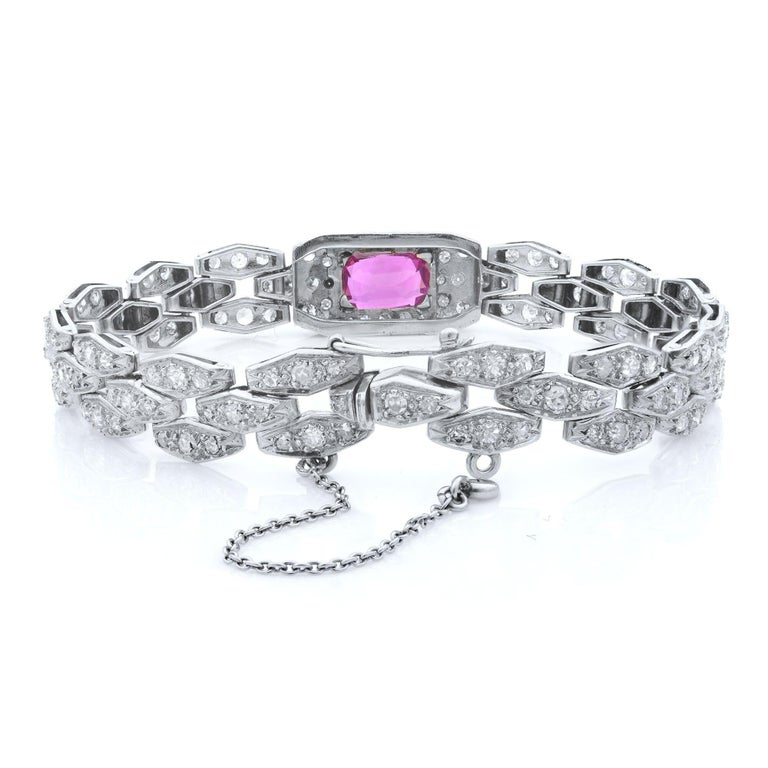 A stunning antique French emerald cut 3.32 carat ruby and 3.31 carat of European lab diamonds bracelet. This piece is part of our diverse antique estate jewelry collection. This fine and impressive antique ruby bracelet with diamonds has been