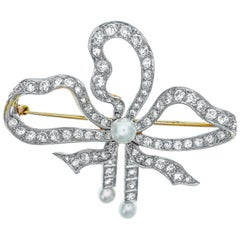 Antique Platinum-Topped Gold, Diamond and Pearl Bow Brooch