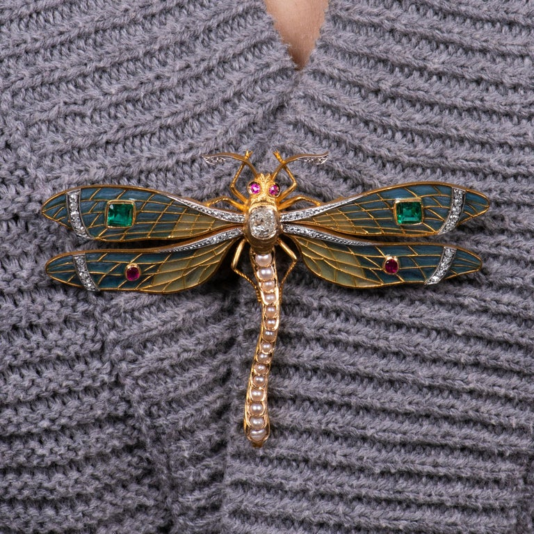 Immaculate  plique a jour dragonfly brooch in 22K yellow gold with one 0.90 carat fine cushion brilliant diamond, 2 fine emerald cut natural emeralds of approx 0.70ct total, measuring approximately 4.05mm each, .25 carats in four natural rubies and